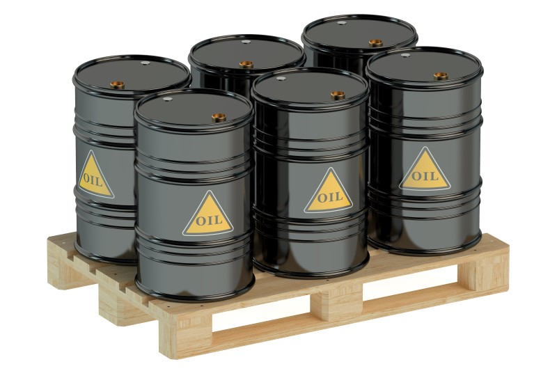 black oil barrels on pallet isolated on white background